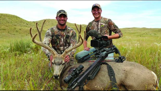 Lucas Mestad (right) is pictured here with Ryan Busbice (left) from A&E's television series 'Country Bucks'  and this huge Mule Deer tagged in Lucas' first Big Game Hunt filming that occurred in Dear Meadows in the Sandhills of Nebraska and aired last Spring.