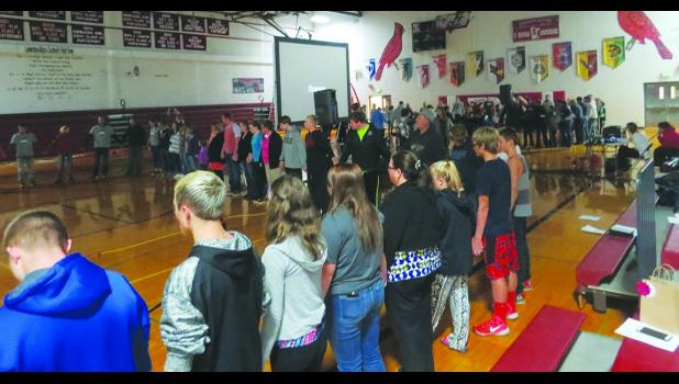 Because of the number of those participating, two circle prayers were made in the gymnasium as each person was given and opportunity to say their prayer aloud or pass to the next person.  Photos by Carol Boynton