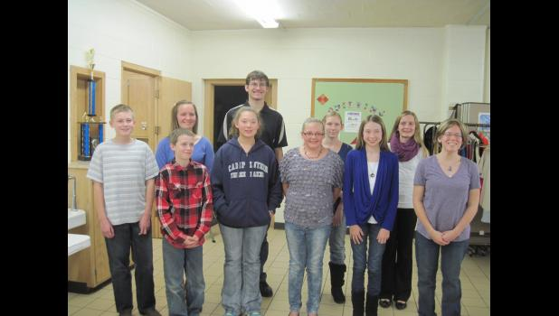 The 2014-15 Russell Corner Badgers 4-H Club officers (left to right, from front) Demonstration Officer Jesse Groell, Sergeant of Arms Kyle Stensen, Sunshine Person Kayleen Strauch, Historian Bethany Strauch, Attendence Officer Heidi Strey, President Abby Groell; (back) Treasurer Nicole Welke, Vice President Dylan Klindworth, Reporter Holly Groell and Secretary Brooke Welke.