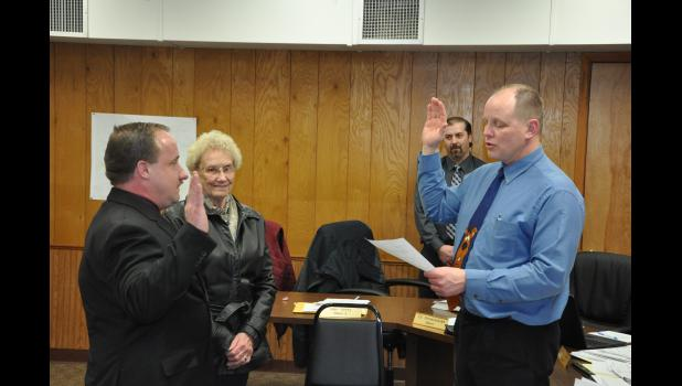 Colin Severson (left) was sworn in as the new Chief of the Mondovi Police Department by Mondovi City Administrator Bradley Hanson on Tuesday evening, Feb. 13. Colin's mom, Gloria Severson, looked on proudly as her son took the oath and renewed a past family connection with the MPD. Colin's grandpa, Oscar Thompson, was a MPD officer years ago.