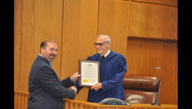 Judge Gary Schlosstein is presented a citation from the Wisconsin Supreme Court by Rep. Treig Pronschinske on behalf of Chief Justice Patience Roggensack in the Buffalo County courtroom on Tuesday, Oct. 2. Schlosstein has served as Buffalo County's Judge for 32 years and another 28 as Court Commissioner.