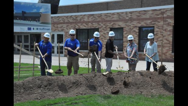 Members of the Mondovi School Board were first to turn dirt during a groundbreaking ceremony on Wednesday, June 5, for the school's $18 million renovation and expansion project that begins this summer. Pictured, left to right, are Board members Chris Rud, Barrett Brenner, Dan Linse, Ron Keys, Jean Sandberg and Lisa Heike.