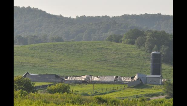 A huge feedlot shed just north of Hwy. Z off Hovey Valley Road owned by Scott Werlein was flattened by the storm.