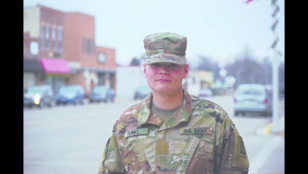 Dakotah Funke, a 2016-17 Plainview-Elgin-Millville High School graduate, stands outside of the Plainview News in uniform on Wednesday, Dec. 20. Funke, who has completed the United State Army's basic training program, will officially graduate on Jan. 18 and 19. Photo by Michael Flicek