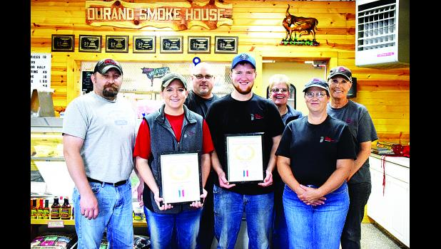 The Durand Smokehouse recently earned two awards at the American Cured Meat Championships in Lexington, Kentucky. Above, from left to right in the front row, are Matt Juliet, Cabrina Grundseth, Mitch Auld, and Kay Sievwright. In the second row are Roy Elsenpeter, Ronda Elsenpeter, and Brenda Jiskra. Laura Berndt photo
