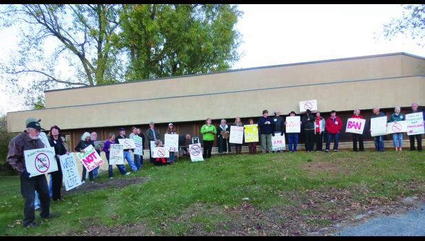 A rally outside the Tandeski Center was held on Thursday, October 13th. People spoke for both sides of the issue.  Some wanting the frac sand ban in place while others proposed a compromise that would limit  numbers and sizes of the mines in Winona County.  Photo by Carol Boynton