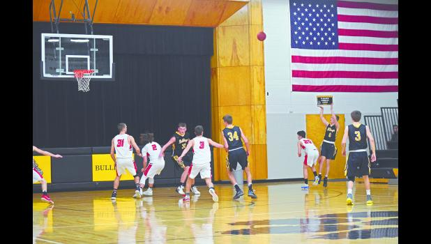 Barron Holtz shoots and drains a 3-pointer early on in the first round of the Section 1AA boys basketball tournament at home on Thursday, March. 1.Photo by Michael Flicek