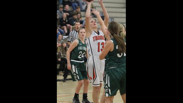 O-F senior captain Sadie Solie rises for a layup over a Cricket defender for two of her 10 points in the victory.
