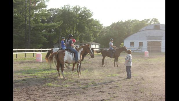 Debbie Bauer, one of the horse project leaders, gives commands and tips to allow project participants to practice for the horse show at this weekend's Pepin County Fair.