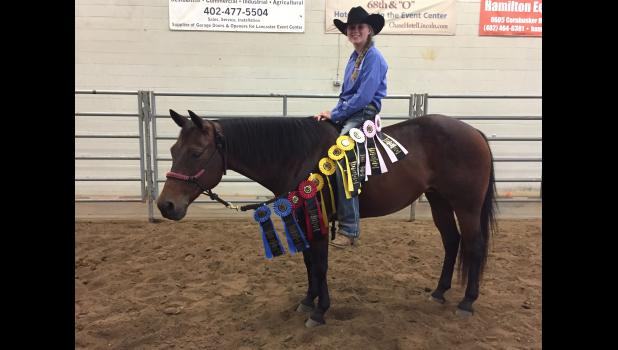 """Mondovi's Kira Lee and her horse, """"Peppy,"""" showed at the Foundation Quarter Horse Registry World Round-Up, held in Lincoln, Neb., last month. Lee has enjoyed a successful summer at FQHR events, topped off with champion and reserve champion honors at Worlds where she competed in gymkhana and ranch pleasure classes."""