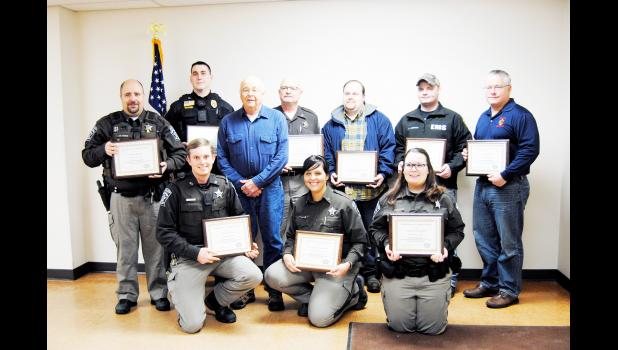Above, from left to right in the front row, are EMT Peter Pillman, Officer Amanda Schwennsen, and Deputy Jennifer Niehoff. In the second row are Officer Jeff Krisik, Durand Police Sergeant Sam Miller, citizen Ronald Asher, Officer Don Sinz, Durand Ambulance Service member Larry Tearman, Durand Ambulance Service member Ryan Anderson, and Durand Firefighter driver Ron Jasperson. Laura Berndt photo