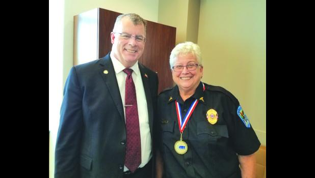 Linda is pictured here with State Senator Mike Goggin, who was elected last November and represents Wabasha at the State Legislature.