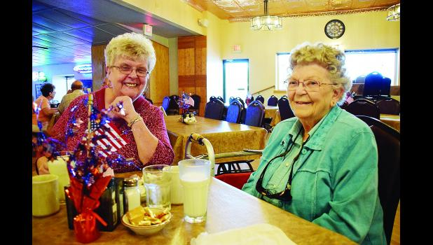 "Sharon ""Sherry"" Heikkinen and Joy Johnson enjoyed lunch during the Corral Bar & Riverside Grill Senior Dining Program's grand opening celebration. Laura Berndt photo"