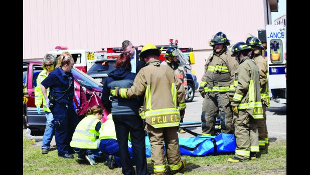 The mother of a student involved in the mock crash at Plum City High School arrives at the scene of the accident. Laura Berndt photo