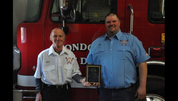 Mondovi Fire Chief Steve Anderson (left) recently presented the fire department's 2017 Firefighter of the Year award to Scot Nogle, who in just five years with the MFD has become a major asset to the organization for his mechanical, fabrication and welding expertise.