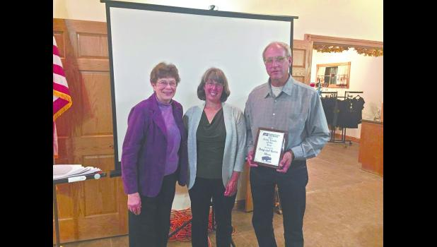 Sharon Fernholz (left) presented Karon and Doug Olson with the 2017 Farm Family of the Year plaque at the Buffalo County Farm Bureau's annual meeting at Danzinger Vineyards in Alma on Oct. 12.