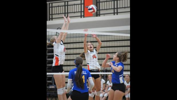 Osseo-Fairchild volleyball players in action during a recent match against Chippewa Falls McDonell