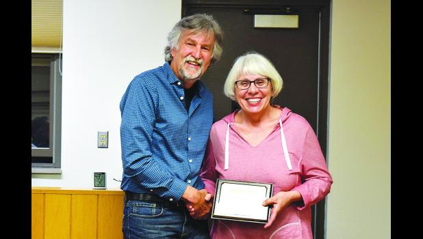 Pepin County Board of Supervisors Chair Dwight Jelle presents Supervisor Dorothy Thompson with a plaque recognizing her service to the County. Thompson has resigned from the Board, effective April 30, 2017. Laura Berndt photo