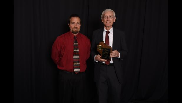 Gilmanton Schools Principal Kory Rud (left) accepted a 2016-17 Wisconsin Title I School of Recognition award for Gilmanton Elementary, presented by State Superintendent Tony Evers at a special ceremony in Madison on May 1.