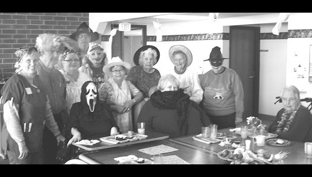 Food and fun often go together, and that was certainly the case on Halloween at Semcac Senior Dining!  Wabasha's diners had a great time, getting in the spirit with their costumes, hats, and accessories.  Standing from left to right are:  Kristi Kropp (site manager), Gale Hill, Jill Schnobrich's sombraro, Dorothy Graner, Dale Moe, Mary Thomas, Gloria Moe, Violet Hall, Lila Roth, and Norma Bulver.  Seated from left to right are Cindy Raymond, Diane Karow, and Helen Volkman.