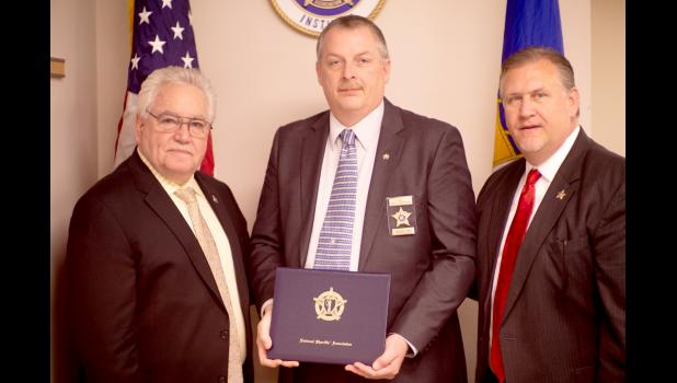 Trempealeau County Sheriff Brett Semingson (center) graduated from the National Sheriffs' Institute, held in Aurora, Colo., April 15-19. The training focused on ensuring local sheriffs have the tools to be effective leaders, mitigating the personalities, strengths, and weaknesses of their executive team.