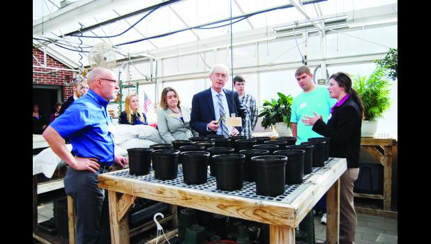 Wisconsin's State Superintendent of Public Instruction Dr. Tony Evers visited Durand Middle/High School last Wednesday, February 22. Above, Dr. Evers (center) learns about a student research project taking place in the school greenhouse, made possible by a UW-Extension partnership.   Laura Berndt photo