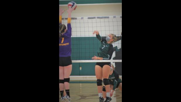 Fall Creek's sophomore middle blocker Gianna Vollrath slams a spike back at Oconto in the WIAA Division 3 Menasha St. Mary's Sectional Tournament championship match last weekend. Photo courtesy of Fall Creek Sports History