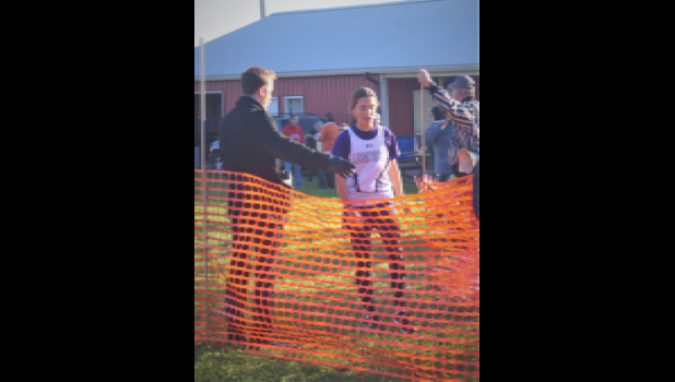 Augusta cross country runner Beth Boone cross the finish line at the Dairyland Conference Meet