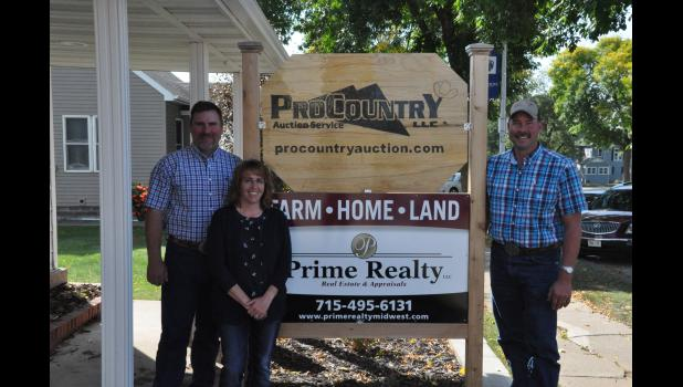 The ProCountry Auction Service office on S. Eau Claire St. recently added a new Prime Realty branch office to connect more effectively with real estate clients. Pictured, realtor Erica Lawton came on board as a Prime Realty agent on Aug. 1, joining longtime auctioneers Scott Werlein (left) and Steve Strey (right).
