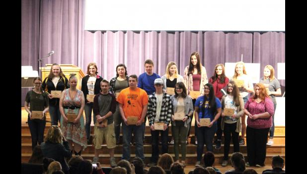 Winners of the different categories for the annual conference art show at Osseo-Fairchild stand in the auditorium.