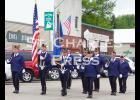 The Eyota American Legion marches from the Legion to join the high school band in the parade. Photo by Nicole L. Czarnomski.