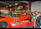 "A long line of Dukes of Hazzard fans wound around the ""General Lee,"" at Cardinal Manufacturing's annual open house event, held Wednesday, Nov. 19, at Eleva-Strum Central."