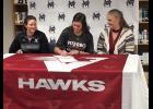 Mondovi High School senior Morgan Mohler signed her commitment to the Viterbo University softball program on Wednesday, Feb. 14, with her mom, Leslie Mohler (right), and V-Hawks head coach Brandi Alonzo by her side. A 2017 all-conference selection, Mohler was the Lady Buffaloes' top batter last season.