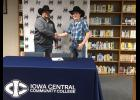 Nick Pelke shook hands with Iowa Central coach Terry Coleman after signing on the dotted line. Coleman said he was excited to sign a talented all-around cowboy like Pelke to the Triton's squad and has high hopes for his future.