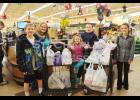The Little Valley Victors purchased food and other necessities at Mike's Food Center in St. Charles, and later donated the items to the Southeast Minnesota Rural Education and Resource Center.