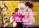 Sofia and Jasmine talk with Santa at the Moose Lodge in St. Charles on Saturday morning.