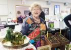 Linda Risser had miniature hand-made terrariums, topiaries and repurposed living landscapes at the Moose Lodge expo on Saturday. Photo by St. Charles Press Staff Writer Nicole L. Czarnomski