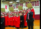 Mr. Matthew Wilmes Lewiston Altura vocal instructor introduces the Senior Choir and their songs that they will be singing for the evening of their Winter Concert 2016.    (Students dressed in black are the seniors of this year).  Mr. Kevin Huseth is the instrumental instructor.  See more photos on Page 14.  Photo by Carol Boynton