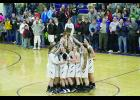 The Durand girls basketball team claimed the regional title on Saturday in Durand with a win over Arcadia.
