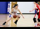 The team listens to advice from coach Tony Hansen during a send-off pep rally at Durand Middle/Senior High School on Friday, October 28. Laura Berndt photo