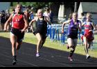 Eleva-Strum's Jaden Bautch is on her way to a regional title in the 100-meter dash. Photo by Beth Kraft